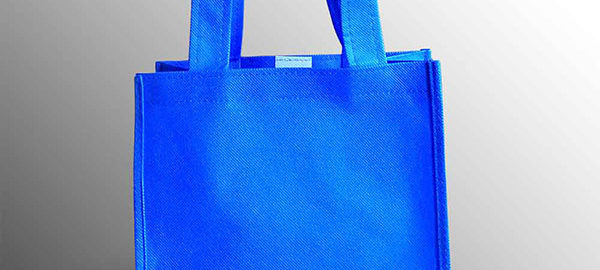 goodie bag polos biru benhur bahan spunbond