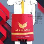 Tas goodie bag bahan spunbond warna merah kombinasi kuning Q5595P